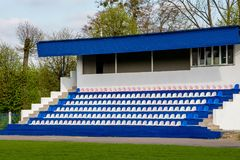 Seating for spectators at small school stadium. _ royalty free stock photo