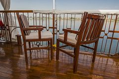 Seating on the sundeck of a river cruise boat stock photo