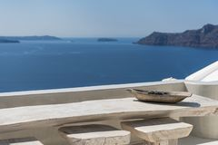 Seating with vew. Seating at balcony in Oia in Santorini with great view royalty free stock photos