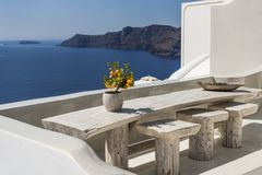 Seating with vew. Seating at balcony in Oia in Santorini with great view stock photography