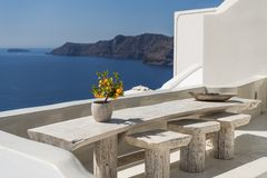 Seating with vew. Seating at balcony in Oia in Santorini with great view royalty free stock image