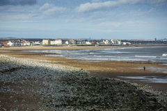 Seaton Carew, hartlepool, cleveland, england. A distant view of Seaton Carew and Hartlepool, Cleveland, England, from Seal Sands on the Tees estuary, with beach Royalty Free Stock Photos