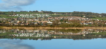 Seaton. Reflected on the water of river Axe in Devon Stock Photography