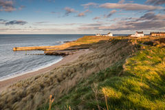 Seaton Sluice from the dunes. Seaton Sluice Harbour is natural formed by the Seaton Burn and is now mainly used by fishing boats Royalty Free Stock Image