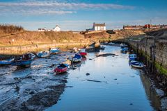 Seaton Sluice Natural Harbour. Seaton Sluice is a village on the Northumberland coast, with a natural harbour formed by the Seaton Burn Royalty Free Stock Images