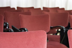 Seats_1. A photo of some red velvet chairs of a theatre Royalty Free Stock Photos