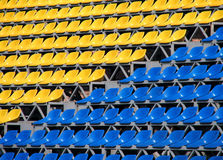 Seats. Yellow and blue sests on a stadium stock images