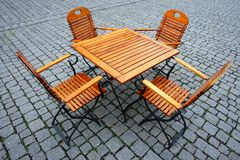 Seats. Picture of some wooden seats and tables outside Royalty Free Stock Image