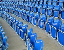 Seats. The photographic image of plastic folding chairs on sports arena Royalty Free Stock Image