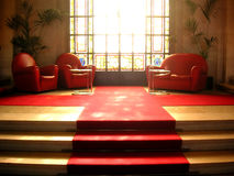 Seats. Next to stained glass window royalty free stock image