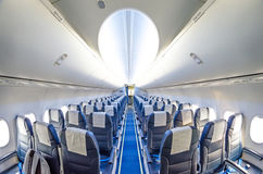 Seats in an airplane aisle Royalty Free Stock Image