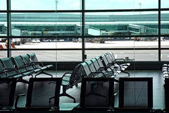 Seats in the airport hall Stock Photos
