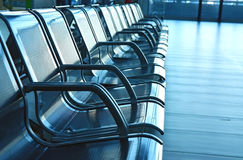 Seats on airport hall. In blue Royalty Free Stock Photo