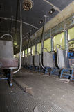 Seats on aisle of abandoned trolley car Stock Photography