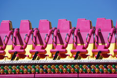 Seats at amusement park Stock Photos