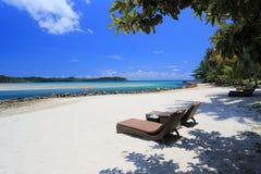 Seats on beach. Seats on tropical beach with clear blue sky Stock Photo