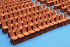 Seats on blue carpet Stock Photography