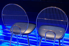 Seats with blue neon glow Royalty Free Stock Photo