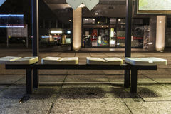 Seats of a bus stop at night in Berlin, Germany. Four seats of a bus stop at night in Berlin, Germany Royalty Free Stock Photo