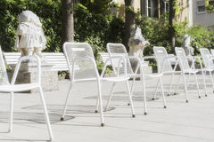 Seats and chairs in the park Hofgarten Augsburg Stock Photo
