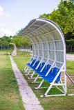 Seats for coaches and athletes on the football field Royalty Free Stock Images