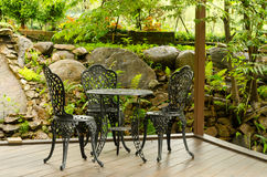Seats in coffee shop garden Royalty Free Stock Images