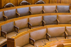 Seats in conference or council chamber. Wood and leather. Stock Images