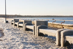 Seats covered with thich ice Royalty Free Stock Photos