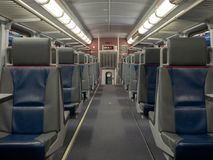 Seats on an empty train cabin ready for departure. Some seats on an empty train cabin ready for departure royalty free stock photos