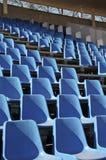 Seats are empty on the tribune of stadium. Empty plastic seats on the tribune of stadium Royalty Free Stock Photo