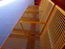Seats. Empty yellow seats in a train station Royalty Free Stock Image