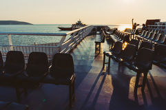 Seats on a ferry at sunset Stock Photo