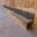 Seats forged iron and stone Royalty Free Stock Photos