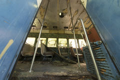 Seats inside abandoned trolley car Royalty Free Stock Photography