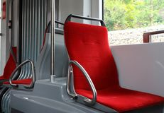 Seats inside the tram stock images