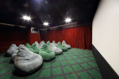 Seats like sacks and baffle-plate in movie theater Stock Image