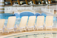 Seats near pool in waterpark Caribia Stock Photo