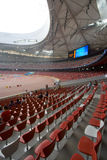 Seats at the Olympic Stadium. Vertical inside view of the Beijing National Olympic Stadium also known as the Bird's Nest featuring red seats. The stadium will Royalty Free Stock Photos