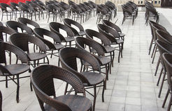 Seats outside. Rows of seats outside a coffee shop Royalty Free Stock Images