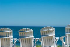 Seats overlooking lake Michigan. Unoccupied seats line the lakefront outside Blue Harbor Resort in Sheboygan royalty free stock photo