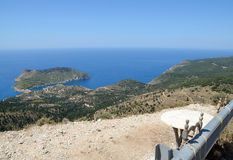 Seats with panoramic view of Assos peninsula Royalty Free Stock Image
