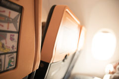 Seats on a plane European travel. A view of the seats and the window inside a plane of a european travel company Stock Photo