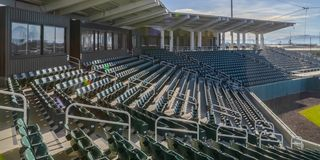 Seats and rooms at a sports arena on a sunny day stock photography