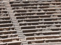 Seats rows Amphitheatre Bosra. Close up of rows of seats and stairway, ancient Roman basalt open amphitheatre, Bosra, Syria Royalty Free Stock Images