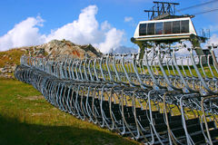 Seats of Ski Lift on the Ground. Ski seats without job in the summer in the French Alps Stock Photo
