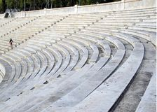 Seats for spectators, tiers of white marble at the Olympic Stadium in Athens. Arena Panathinaikos in the center of the capital of Greece, top view on the seat stock image