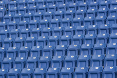 Seats in a Stadium. Blue seats in a stadium. These seats are numbered and make an ideal background stock photo