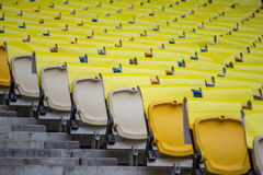 Seats in stadium. Seats with paper cover at the stadium Stock Images