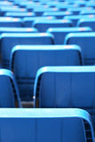 The seats of a stadium, small depth of field Stock Images