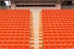 Seats on stadium steps bleacher with spot light pole Stock Images
